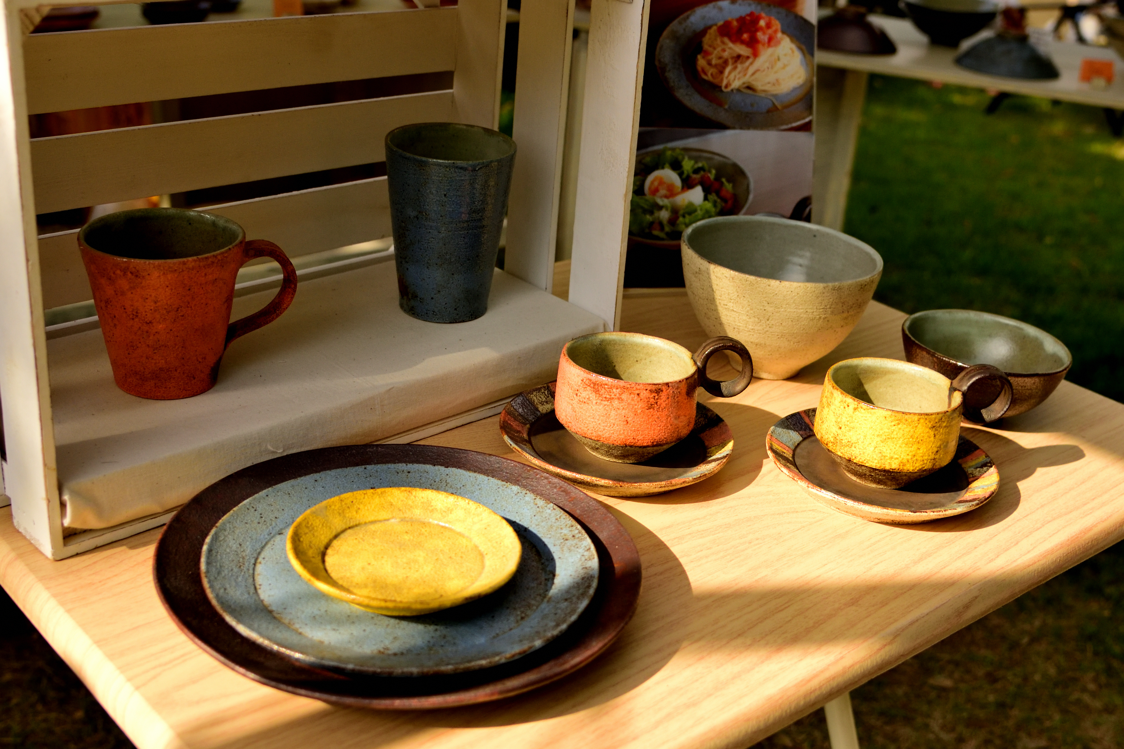 Wood desk and pottery plate in Craftfair Matsumoto